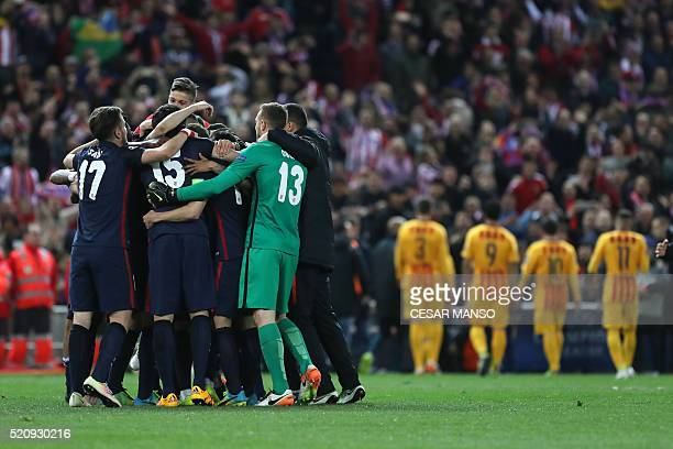 Atletico Madrid's players celebrate their win during the Champions League quarter-final second leg football match Club Atletico de Madrid VS FC...