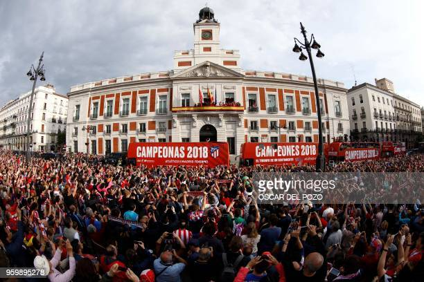 TOPSHOT Atletico Madrid's players greet supporters from the balcony of the headquarters of the regional government of Madrid as they celebrate their...