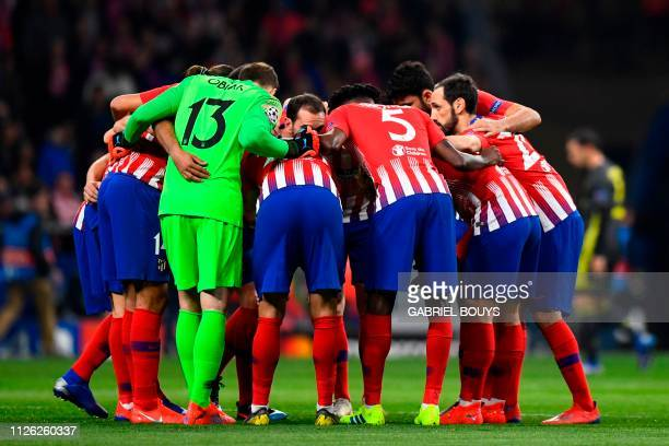 Atletico Madrid's players huddle before the UEFA Champions League round of 16 first leg football match between Club Atletico de Madrid and Juventus...
