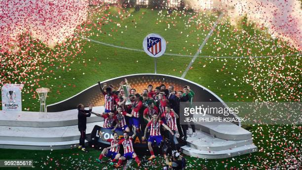 TOPSHOT Atletico Madrid's players pose with the trophy after winning the UEFA Europa League final football match between Olympique de Marseille and...