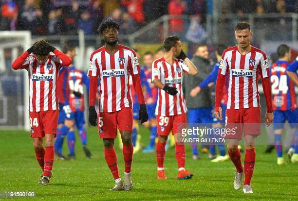 Atletico Madrid's players react to their defeat at the end of the Spanish league football match SD Eibar against Club Atletico de Madrid at the...