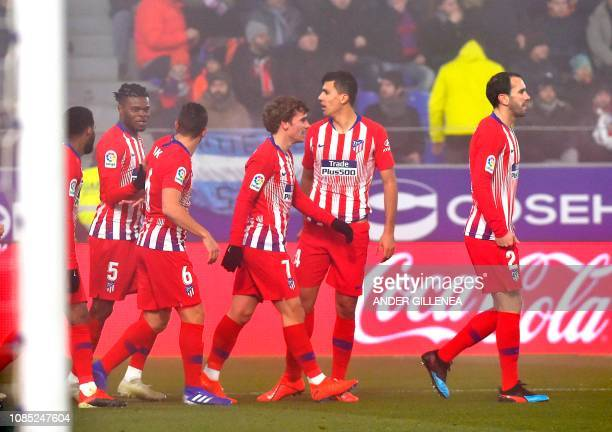 Atletico Madrid's plsyers celebrate after Atletico Madrid's Colombian defender Santiago Arias scored during the Spanish League football match between...