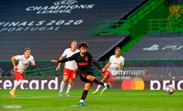 Atletico Madrid's Portuguese forward Joao Felix celebrates after scoring a goashoots a penalty kick to score a goal during the UEFA Champions League...