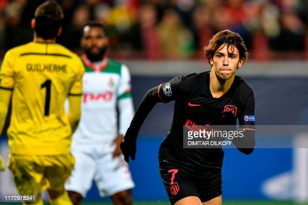 Atletico Madrid's Portuguese forward Joao Felix celebrates after scoring a goal during the UEFA Champions League Group D football match between...