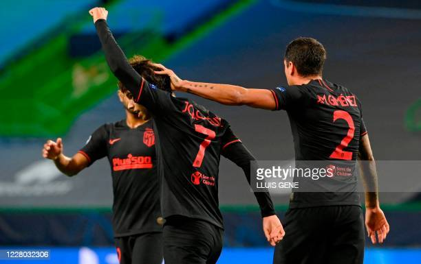 Atletico Madrid's Portuguese forward Joao Felix celebrates after scoring a goal during the UEFA Champions League quarter-final football match between...