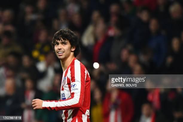 TOPSHOT Atletico Madrid's Portuguese forward Joao Felix celebrates after scoring during the Spanish league football match Club Atletico de Madrid...