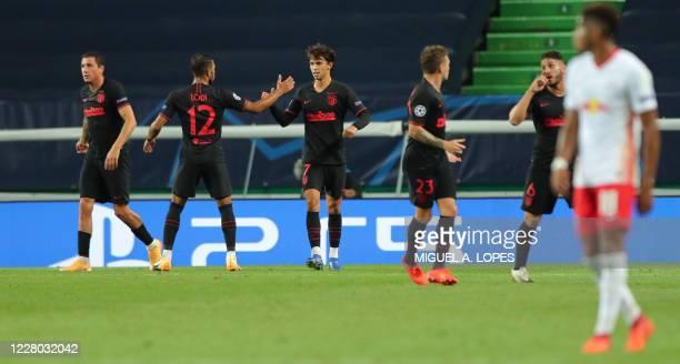 Atletico Madrid's Portuguese forward Joao Felix celebrates with teammates after scoring a goal during the UEFA Champions League quarter-final...