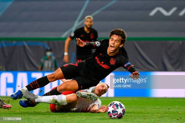 Atletico Madrid's Portuguese forward Joao Felix is fouled by Leipzig's German defender Lukas Klostermann during the UEFA Champions League...