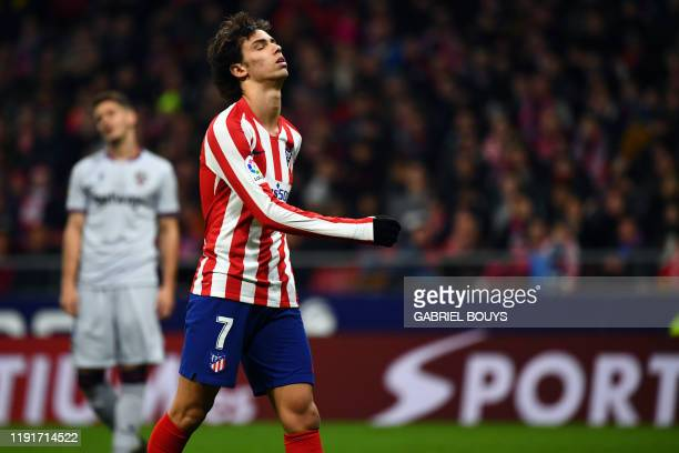 Atletico Madrid's Portuguese forward Joao Felix reacts to missing a goal opportunity during the Spanish league football match between Club Atletico...