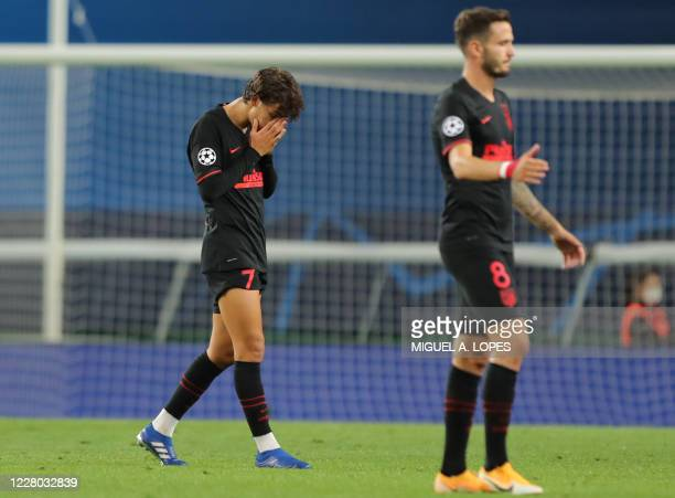 Atletico Madrid's Portuguese forward Joao Felix reacts to their defeat at the end of the UEFA Champions League quarter-final football match between...