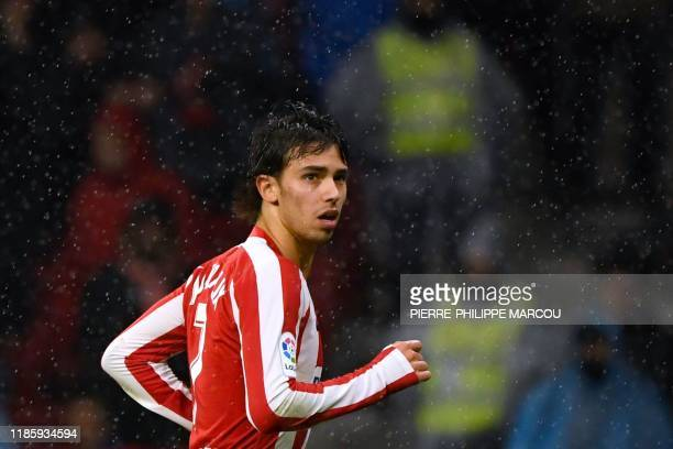 Atletico Madrid's Portuguese forward Joao Felix runs during the Spanish league football match between Club Atletico de Madrid and FC Barcelona at the...