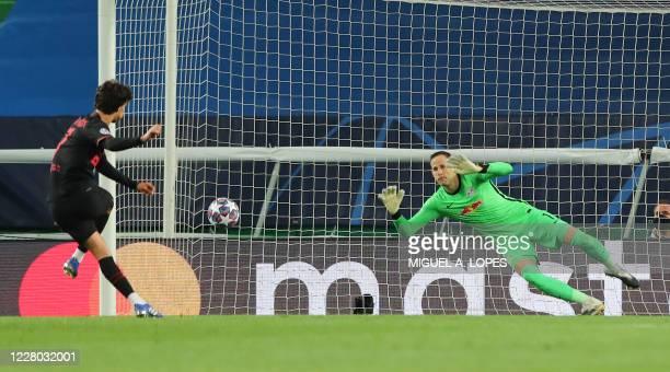 Atletico Madrid's Portuguese forward Joao Felix shoots a penalty kick to score a goal during the UEFA Champions League quarter-final football match...