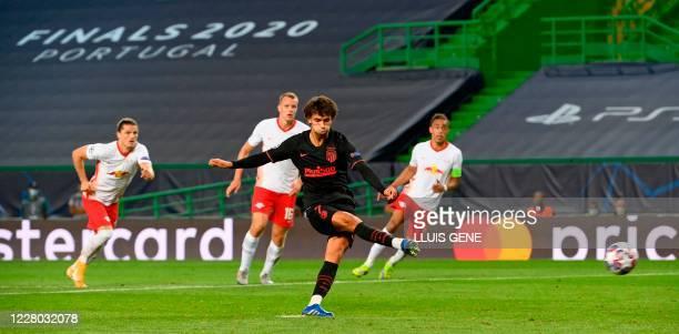 Atletico Madrid's Portuguese forward Joao Felix shoots to score a goal during the UEFA Champions League quarter-final football match between Leipzig...