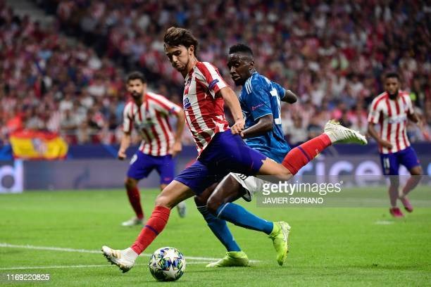 TOPSHOT Atletico Madrid's Portuguese forward Joao Felix vies with Juventus' French midfielder Blaise Matuidi during the UEFA Champions League Group D...