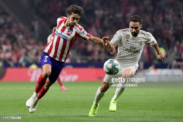 TOPSHOT Atletico Madrid's Portuguese forward Joao Felix vies with Real Madrid's Spanish defender Dani Carvajal during the Spanish league football...