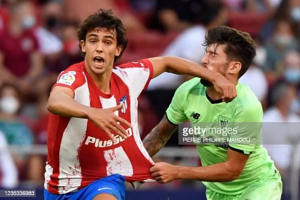 Atletico Madrid's Portuguese midfielder Joao Felix fouls Athletic Bilbao's Spanish midfielder Unai Vencedor during the Spanish League football match...