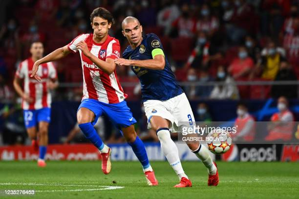 Atletico Madrid's Portuguese midfielder Joao Felix vies with FC Porto's Portuguese defender Pepe during the UEFA Champions League first round group B...
