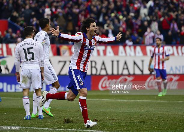 Atletico Madrid's Portuguese midfielder Tiago celebrates after scoring during the Spanish league football match Club Atletico de Madrid vs Real...