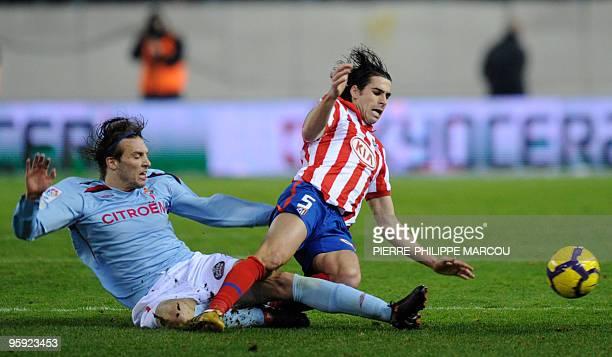 Atletico Madrid's Portuguese midfielder Tiago Mendes vies with Celta de Vigo's Spanish midfielder Miguel Pérez Cuesta during their King's Cup...