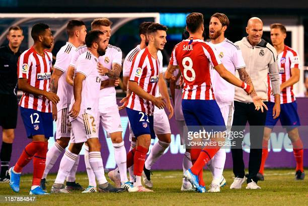 Atletico Madrid's Saul Niguez brawls with players from Real Madrid during the 2019 International Champions Cup football match between Real Madrid and...