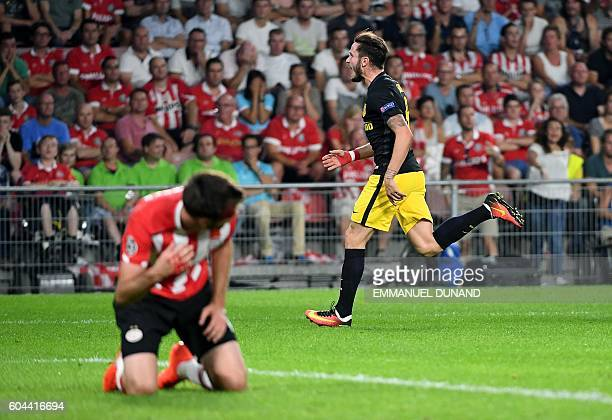 Atletico Madrid's Saul Niguez celebrates after scoring a goal during the UEFA Champions League football match between PSV Eindhoven and Atletico...