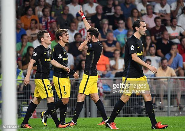 Atletico Madrid's Saul Niguez celebrates after scoringa goal during the UEFA Champions League football match between PSV Eindhoven and Atletico...