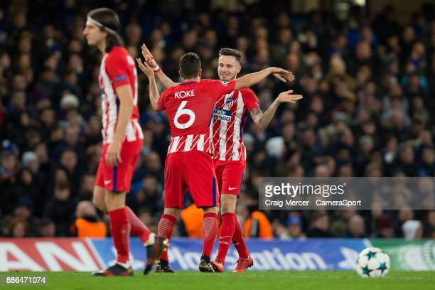 Atletico Madrid's Saul Niguez celebrates scoring the opening goal with team mate Koke during the UEFA Champions League group C match between Chelsea...