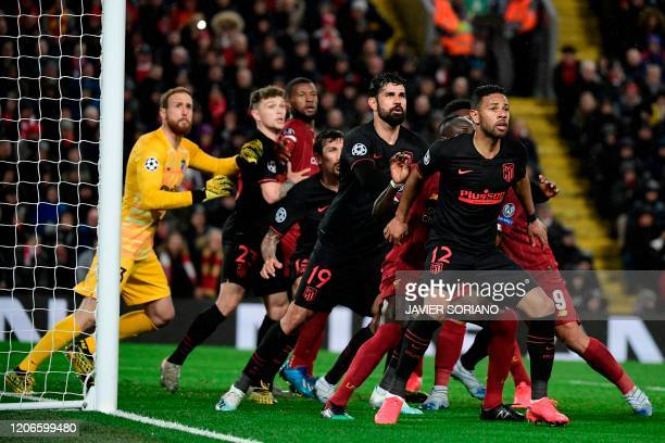 Atletico Madrid's Slovenian goalkeeper Jan Oblak and the defence line up during the UEFA Champions league Round of 16 second leg football match...
