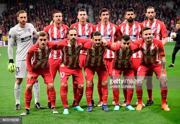 Atletico Madrid's Slovenian goalkeeper Jan Oblak Atletico Madrid's Spanish midfielder Gabi Atletico Madrid's French defender Lucas Hernandez Atletico...