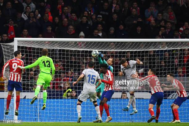 Atletico Madrid's Slovenian goalkeeper Jan Oblak clears the ball during the Spanish league football match between Club Atletico de Madrid and Levante...