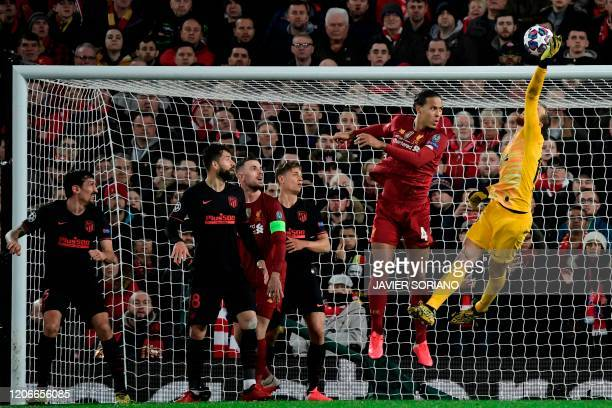 Atletico Madrid's Slovenian goalkeeper Jan Oblak clears the ball during the UEFA Champions league Round of 16 second leg football match between...