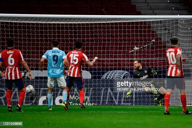 Atletico Madrid's Slovenian goalkeeper Jan Oblak concedes a goal during the Spanish league football match between Club Atletico de Madrid and RC...