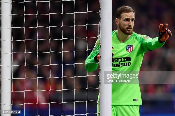 Atletico Madrid's Slovenian goalkeeper Jan Oblak gestures during the UEFA Champions League round of 16 first leg football match between Club Atletico...