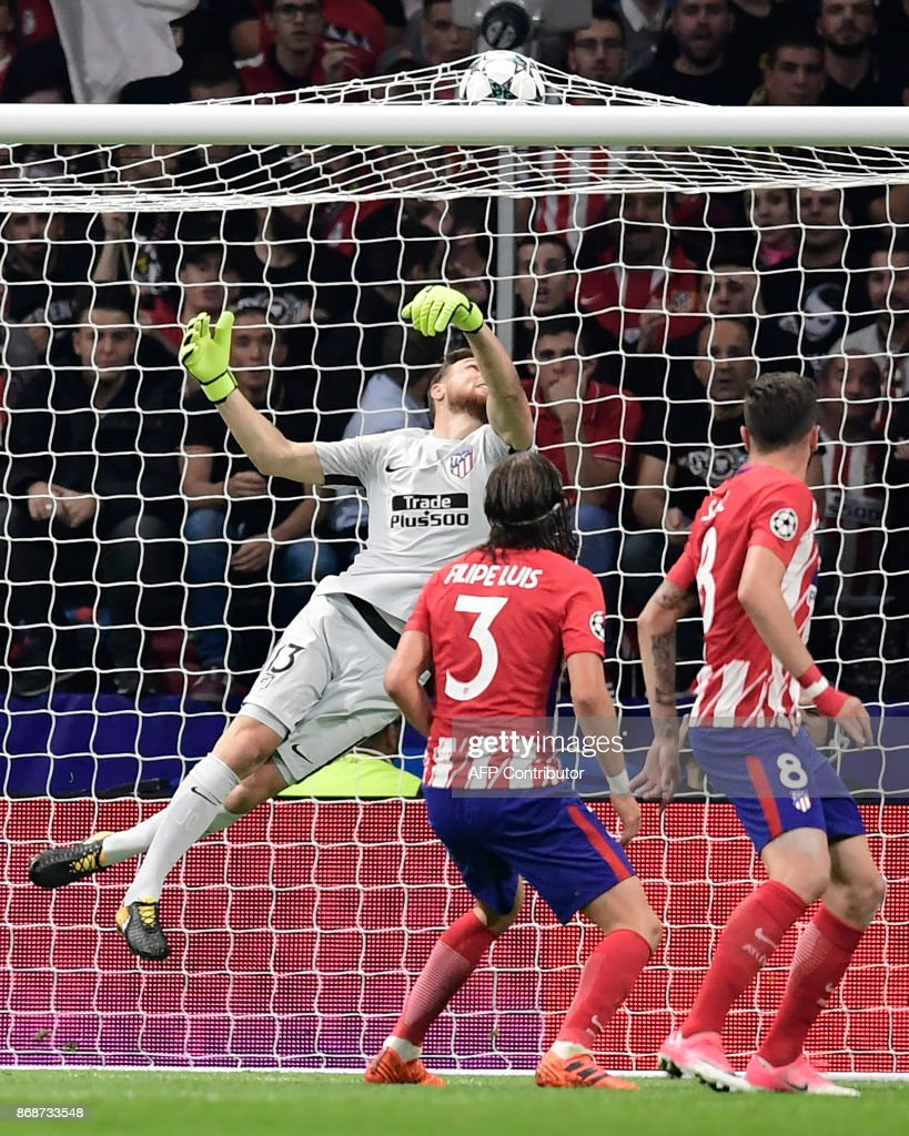Atletico Madrid's Slovenian goalkeeper Jan Oblak (L) looks at the ball touching the net after a goal by Qarabag's Spanish midfielder Michel during the UEFA Champions League football match Club Atletico de Madrid vs Qarabag FK at the Wanda Metropolitano stadium in Madrid on October 31, 2017. /