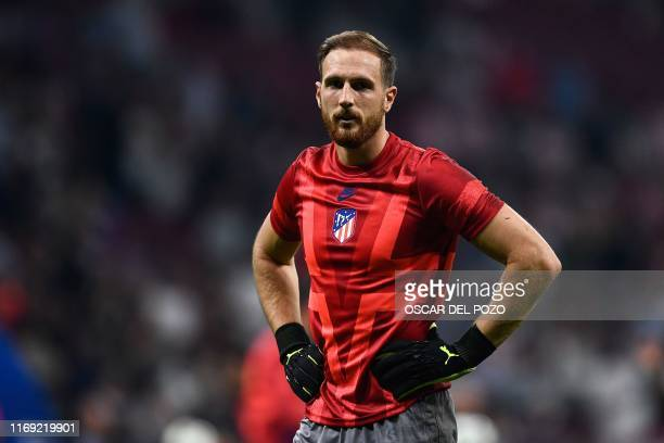 Atletico Madrid's Slovenian goalkeeper Jan Oblak looks on prior to the UEFA Champions League Group D football match between Atletico Madrid and...