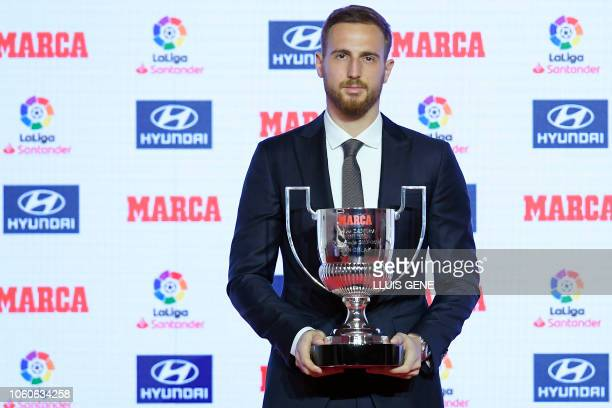 Atletico Madrid's Slovenian goalkeeper Jan Oblak poses after receiving the Zamora trophy for the 2017-18 goalkeeper who conceded least goals of the...