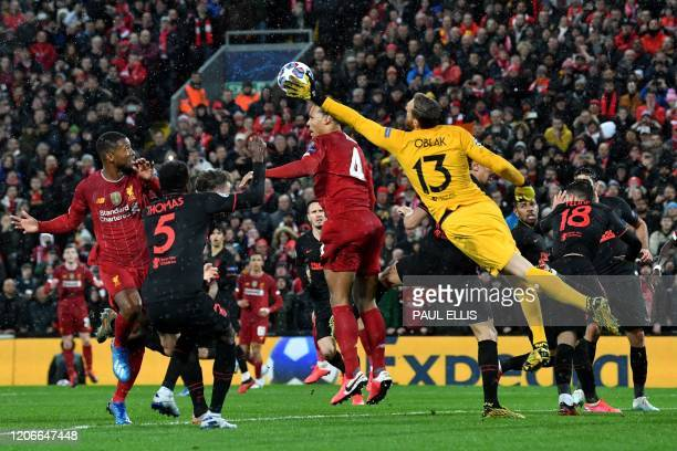 Atletico Madrid's Slovenian goalkeeper Jan Oblak punches the ball clear during the UEFA Champions league Round of 16 second leg football match...