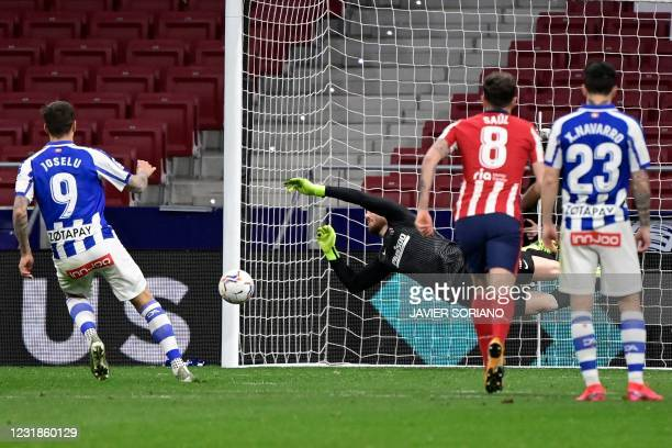 Atletico Madrid's Slovenian goalkeeper Jan Oblak stops a penalty kick by Alaves' Spanish forward Joselu during the Spanish League football match...