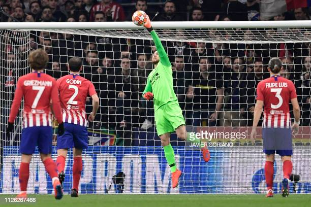Atletico Madrid's Slovenian goalkeeper Jan Oblak stops the ball during the UEFA Champions League round of 16 first leg football match between Club...