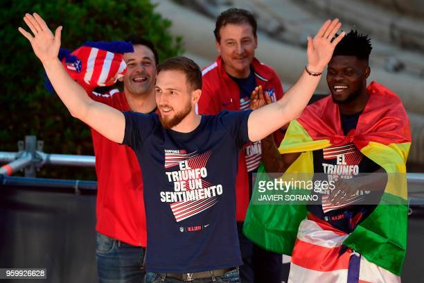 Atletico Madrid's Slovenian goalkeeper Jan Oblak waves at supporters during celebrations for their Europa League victory at the Fountain of Neptune...