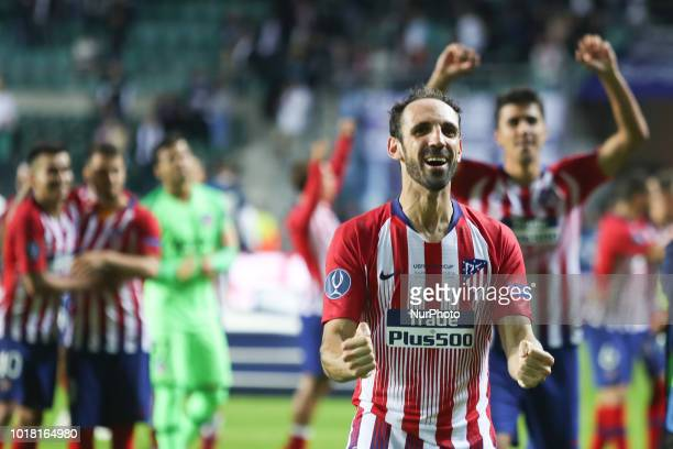 Atletico Madrid's Spanish defender Juanfran celebrates the victory at the end of the UEFA Super Cup football match between Real Madrid and Atletico...