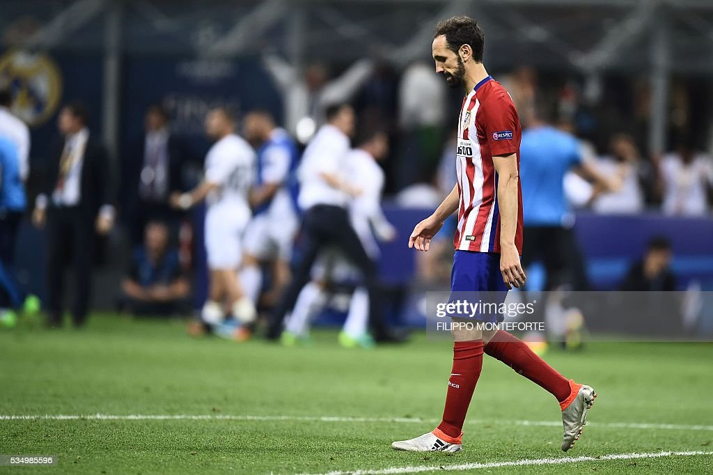 Atletico Madrid's Spanish defender Juanfran reacts after he failed to score during the penalty shoot-out in the UEFA Champions League final football match between Real Madrid and Atletico Madrid at San Siro Stadium in Milan, on May 28, 2016. / AFP / FILIPPO