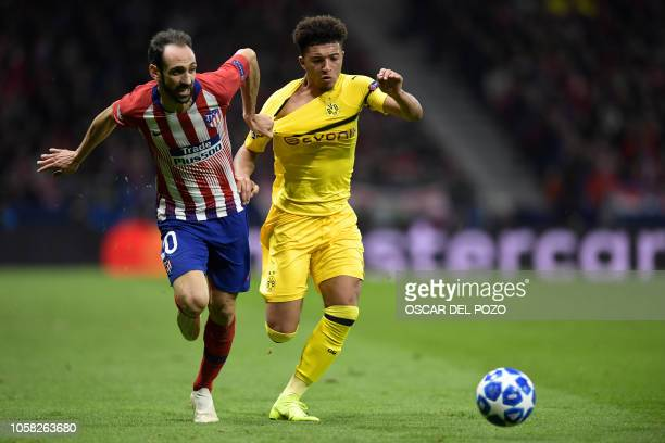 Atletico Madrid's Spanish defender Juanfran vies with Borussia Dortmund's English midfielder Jadon Sancho during the UEFA Champions League group A...