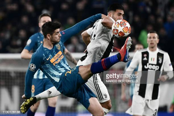 Atletico Madrid's Spanish forward Alvaro Morata and Juventus' German midfielder Emre Can go for the ball during the UEFA Champions League round of 16...