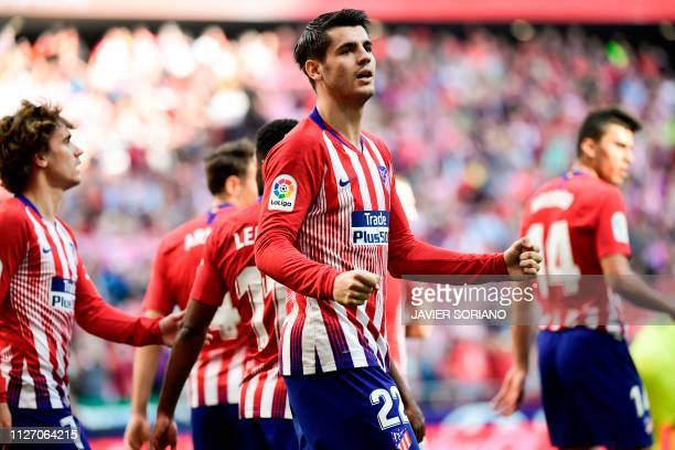 TOPSHOT Atletico Madrid's Spanish forward Alvaro Morata celebrates with teammates after scoring a goal during the Spanish league football match...