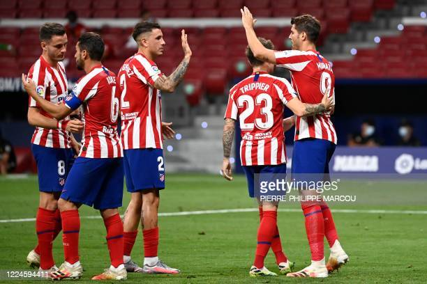 Atletico Madrid's Spanish forward Alvaro Morata celebrates with teammates after scoring a goal during the Spanish League football match between...