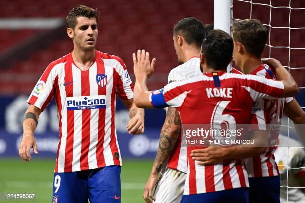 Atletico Madrid's Spanish forward Alvaro Morata celebrates with teammates after scoring a second goal during the Spanish League football match...