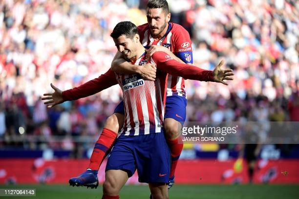 Atletico Madrid's Spanish forward Alvaro Morata celebrates with Atletico Madrid's Spanish midfielder Koke after scoring a goal during the Spanish...
