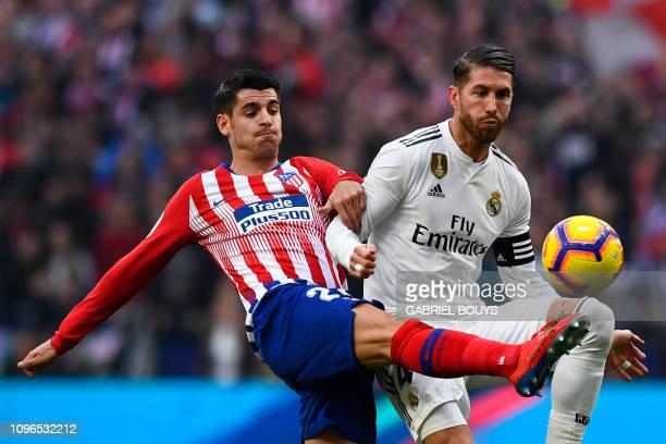 Atletico Madrid's Spanish forward Alvaro Morata challenges Real Madrid's Spanish defender Sergio Ramos during the Spanish league football match...