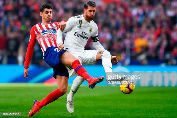 Atletico Madrid's Spanish forward Alvaro Morata challenges Real Madrid's Spanish defender Sergio Ramos during the Spanish league football match...